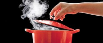the hand opens the lid of the pot of boiling water